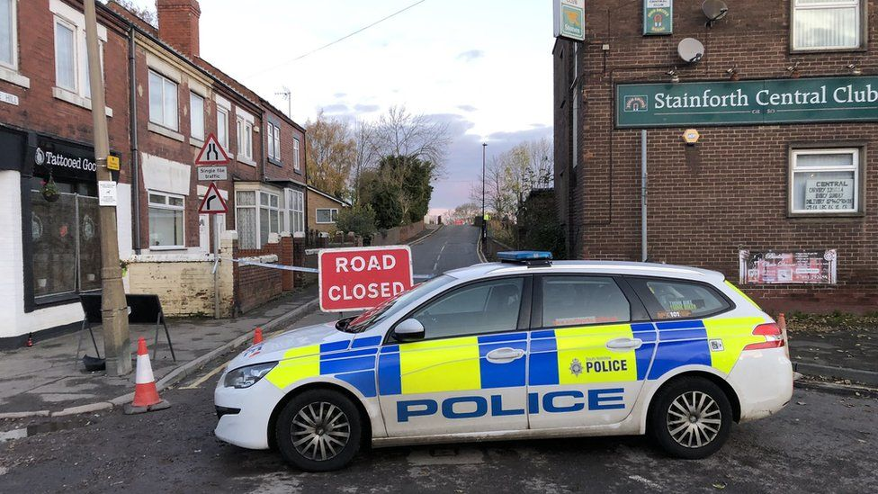 Police car in front of a closed road