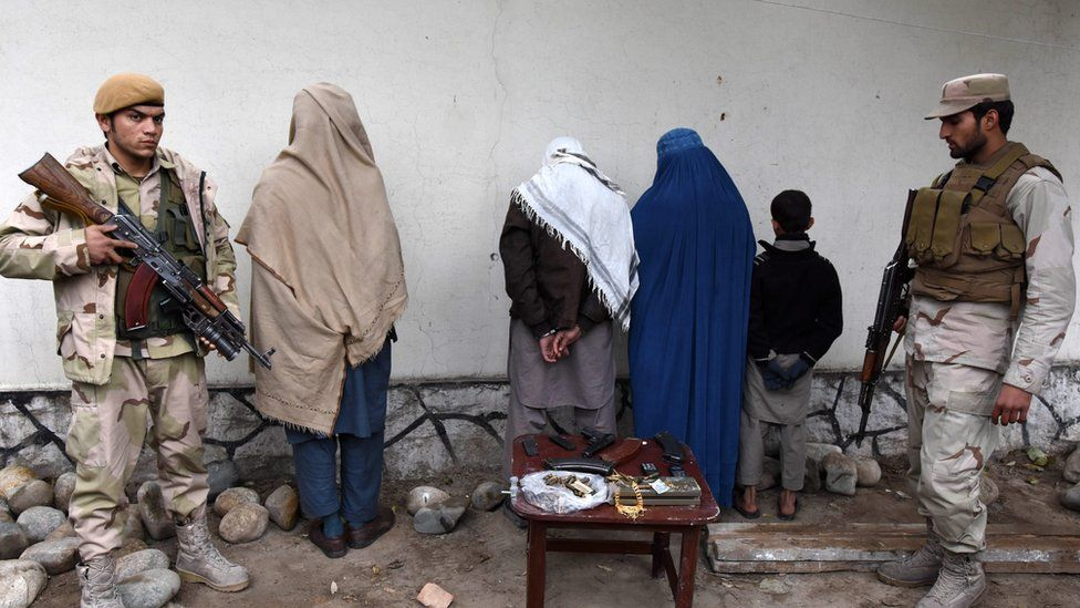 Afghan security forces show four suspected members of the Islamic State group captured in Nangarhar province where IS and Taliban fighters have battled each other