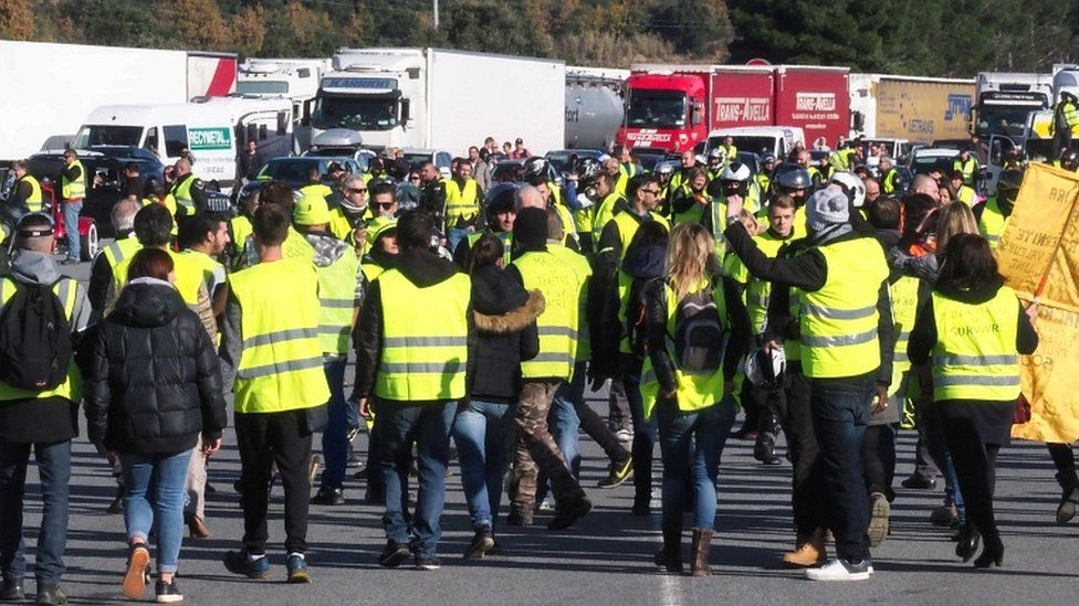 Protesters demonstrate at the A9 highway toll of Le Boulou, southern France on 22 December 2018