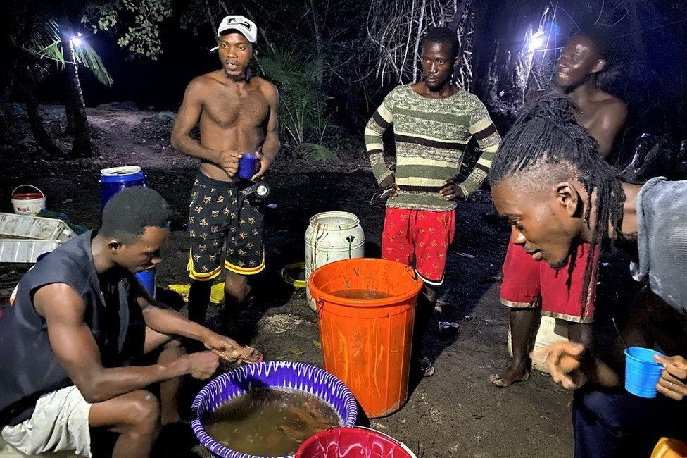Men standing around at night