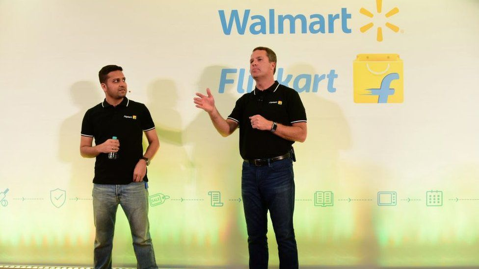 Walmart CEO Doug McMillon (R) speaking next to Flipkart co-founder and CEO Binny Bansal at an event in Bangalore
