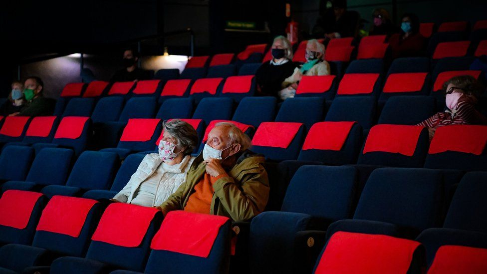 Cinema audiences watch Nomadland inside a movie theatre screen at Chapter, Cardiff, as indoor hospitality and entertainment venues reopen to the public following the further easing of lockdown restrictions in Wales.