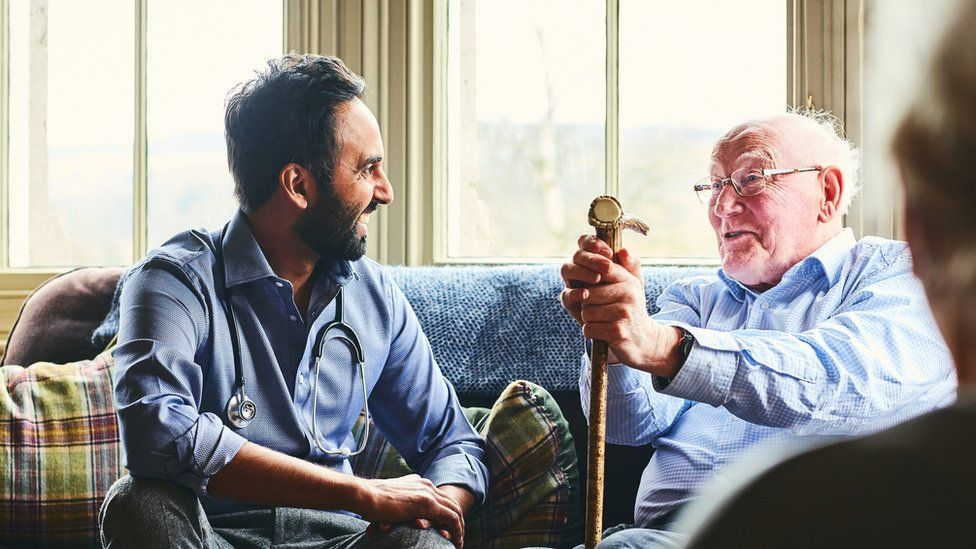 A man visiting his relative in a care home