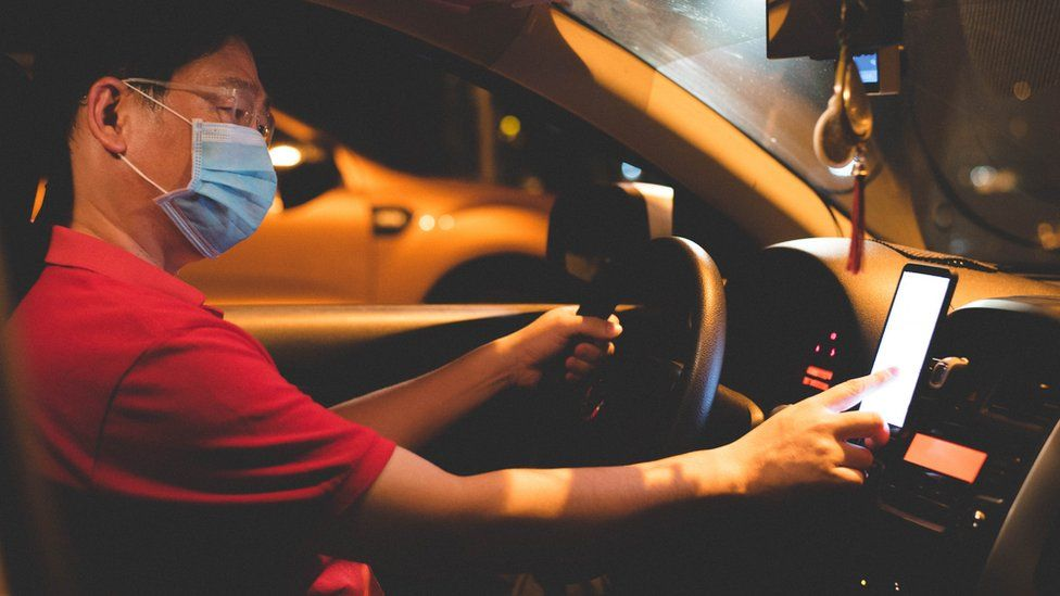 woman driver in mask