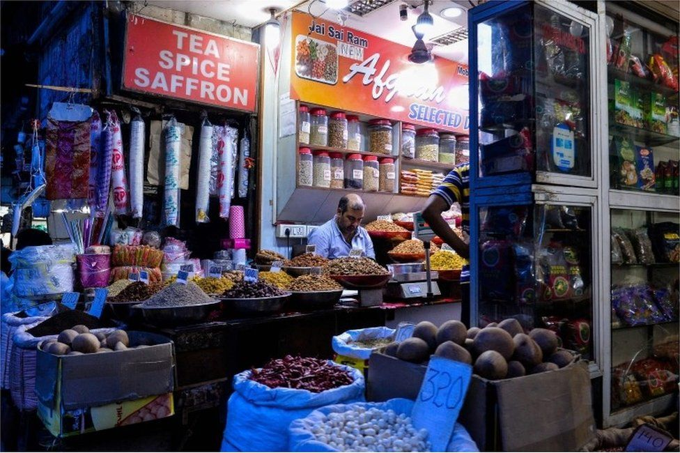 "In this photograph taken on August 2, 2016, an Indian vendor works in his shop in the old quarters of New Delhi. India""s politicians are set to debate the Goods and Services Tax(GST) in the Rajya Sabha (Upper House) of the country""s parliament on August 3, potentially the biggest reform in India""s indirect tax structure in the last quarter century."