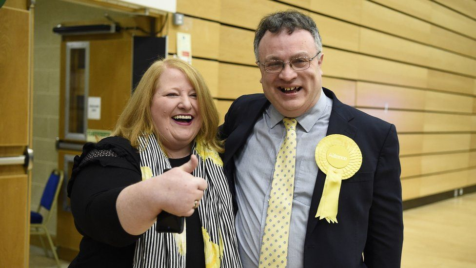 Stephen Farry celebrates with Alliance Party leader Naomi Long
