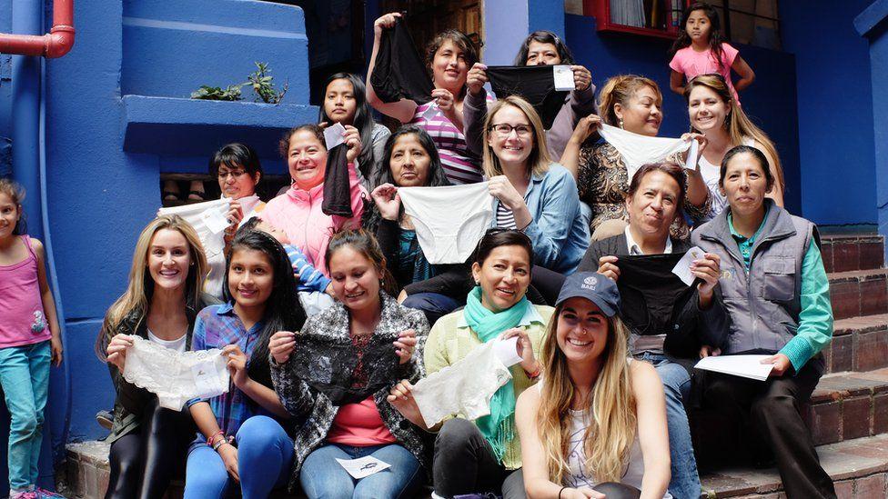 Women holding up MADI lingerie