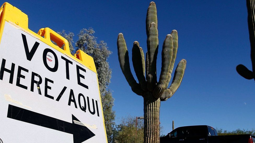 A sign directs voters to a polling station in Cave Creek, Arizona, on 8 November 2016