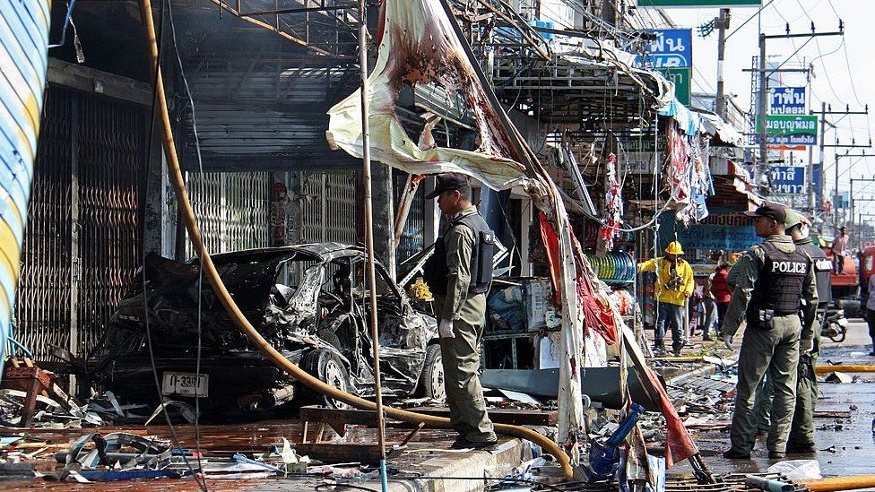 Thai bomb squad officers inspect the site of a bomb blast in Thailand's restive southern province of Yala