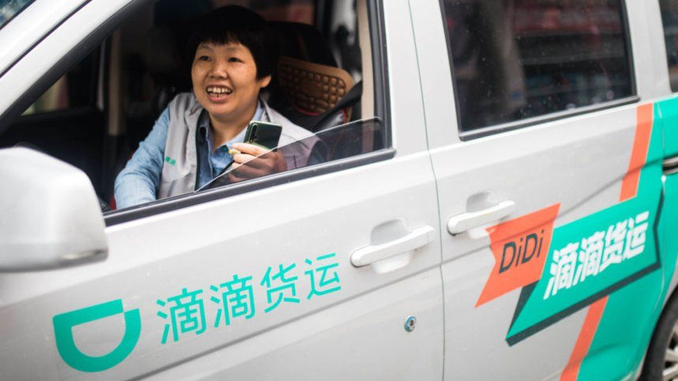 Didi on-demand delivery driver in vehicle.