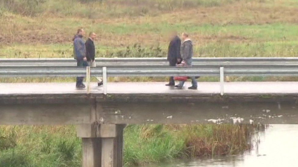 The swap taking place on a bridge separating the two countries