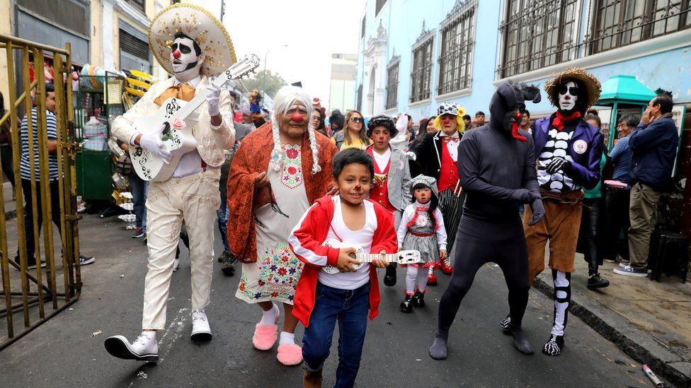 """Clowns attend a parade during Peru""""s Clown Day celebrations in Lima, Peru May 25, 2018"""