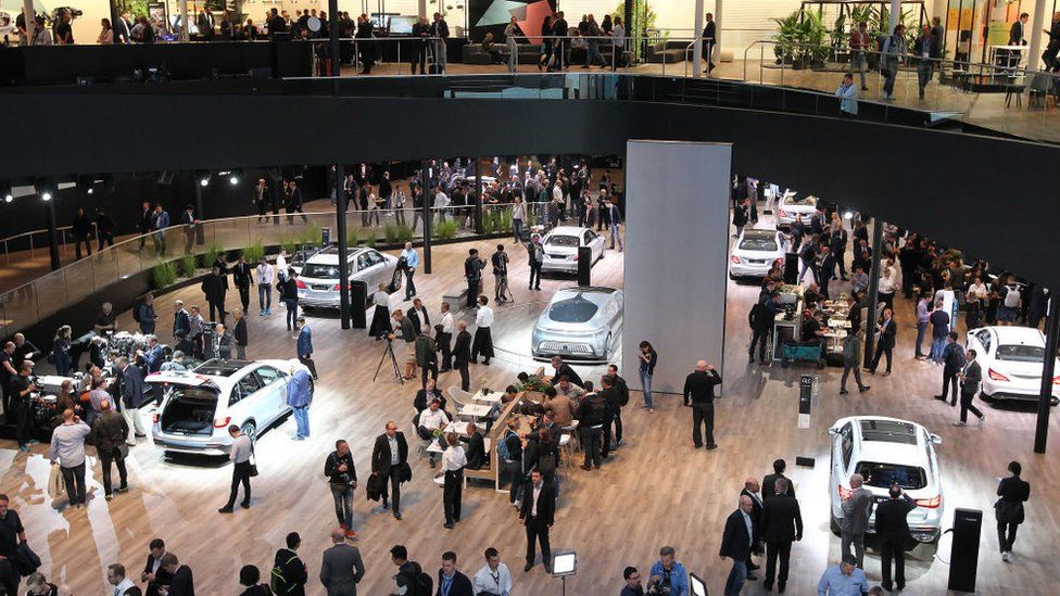 Spectators at the booth of German carmaker Mercedes at the 2017 Frankfurt Motor Show