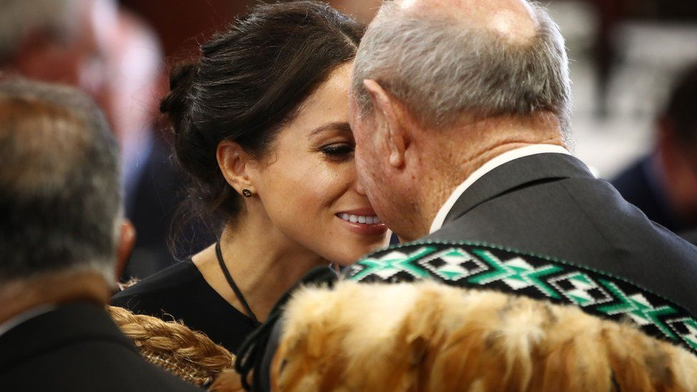 "Meghan, Duchess of Sussex receives a ""hongi"", or traditional Maori greeting on a visit to Te Papaiouru marae in Rotorua on October 31, 2018"