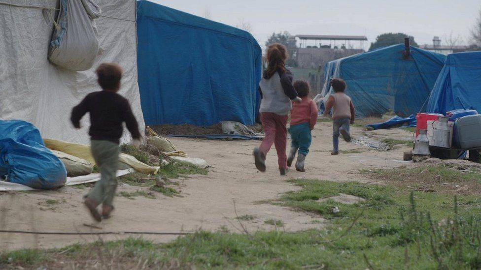 Children play in a makeshift settlement in Turkey