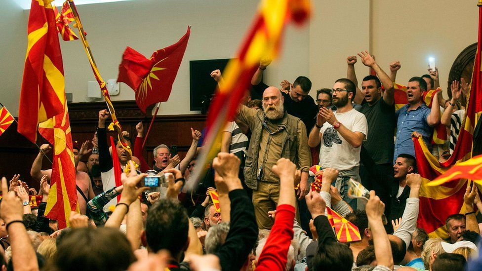 Many of the protesters brought Macedonia's national flag