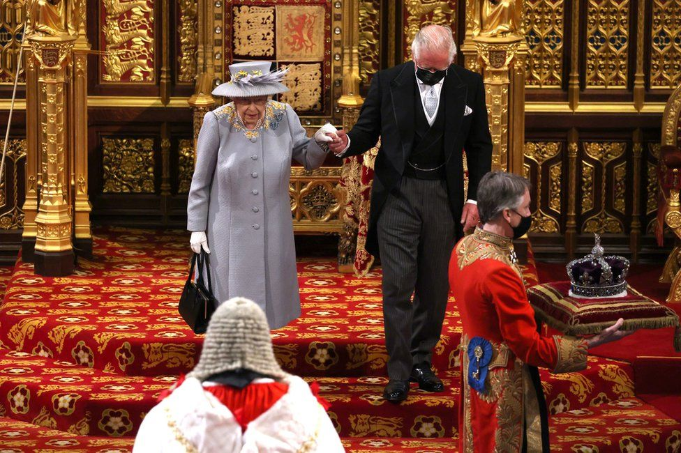 Queen Elizabeth II leaves the House of Lords after delivering the Queen's Speech