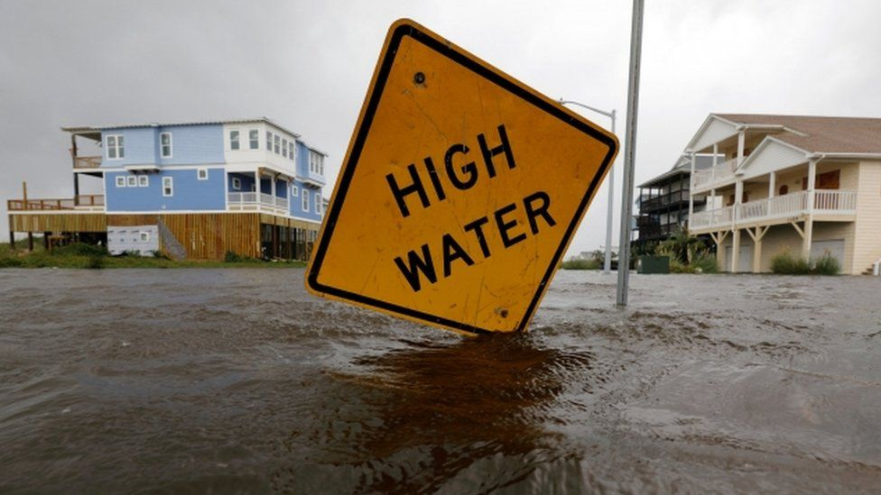 """A """"high water"""" sign is seen amid flooding in North Carolina"""