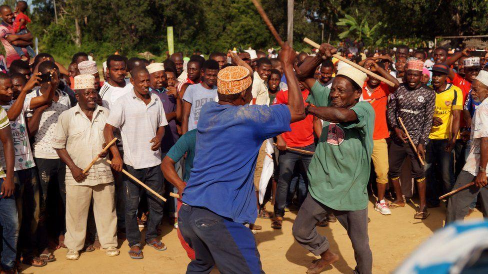 Participants performing a martial arts dance