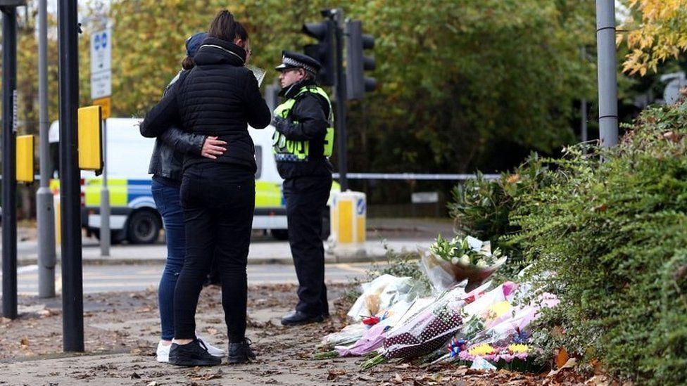 Mourners near tram derailment site