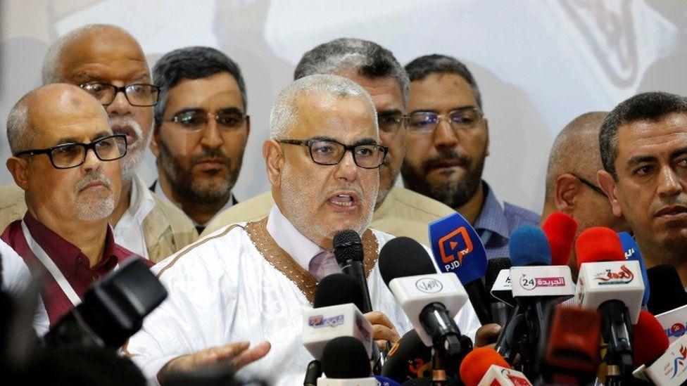 Prime Minister Abdelilah Benkirane (centre) speaks in Rabat, 8 October 2016