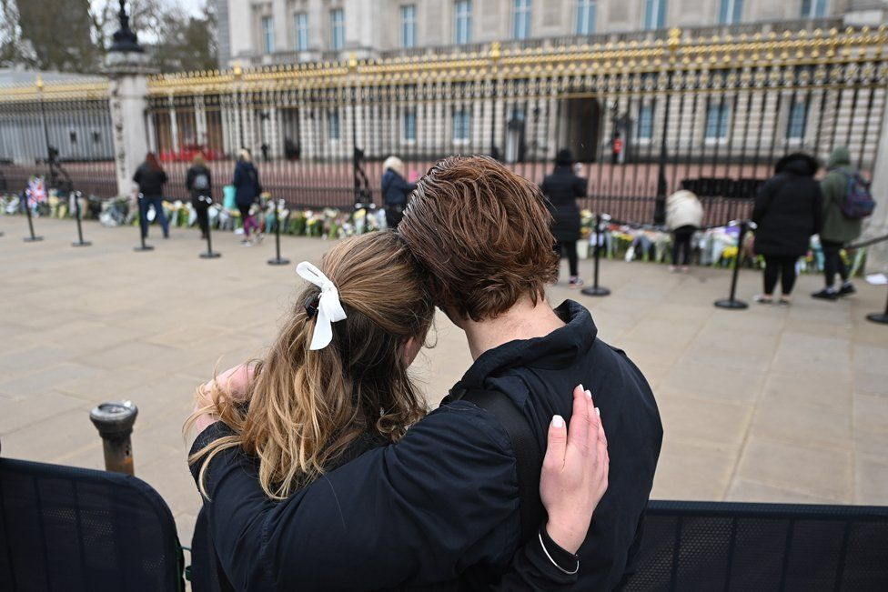 people gather outside Buckingham Palace a day after the passing of Britain's Prince Philip in London. 10 April 2021.