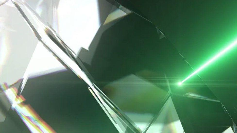 Diamond and laser beam graphic