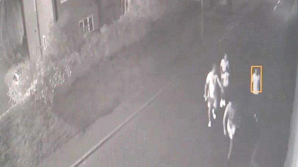 CCTV footage of four people