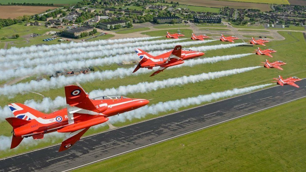 Red Arrows flying over RAF Scampton runway