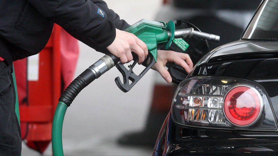Driver fills up at petrol pump