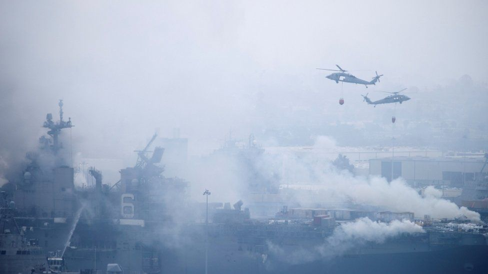 US Navy helicopters try to contain fire on USS Bonhomme Richard. Photo: July 2020