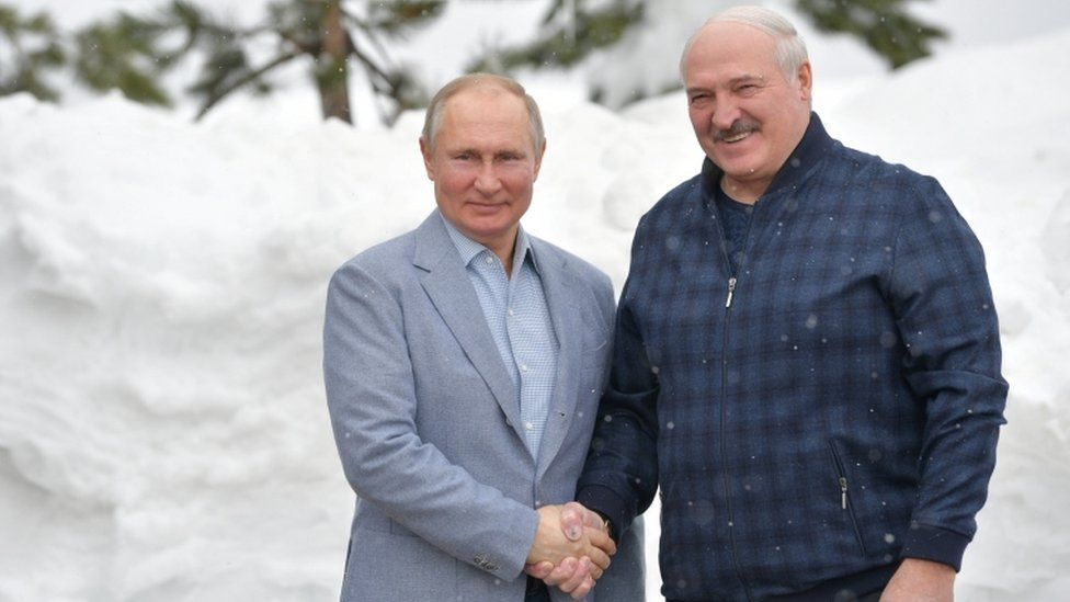 Russian President Vladimir Putin shakes hands with his Belarusian counterpart Alexander Lukashenko during a meeting in Sochi, Russia February 22, 2021