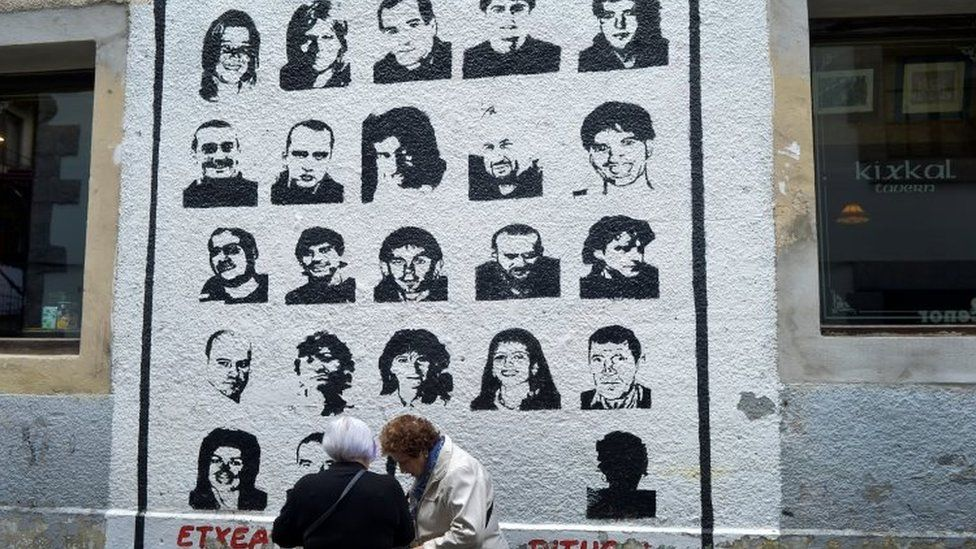 """A mural depicting imprisoned armed Basque group Eta members, under which reads """"We Want Them Home"""", in the Basque town of Hernani (31 March 2017)"""