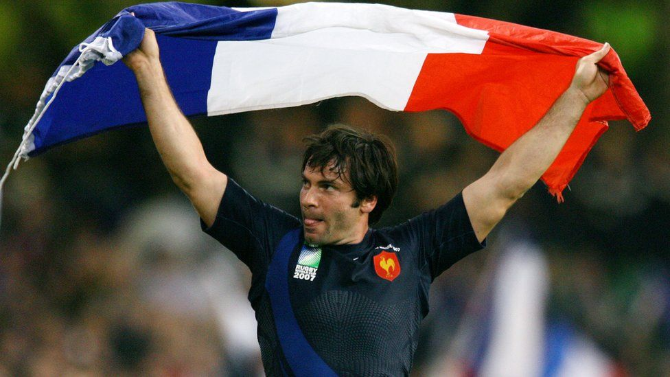 France's Christophe Dominici celebrates after the quarter-final Rugby World Cup match against New Zealand in Cardiff October 6, 2007