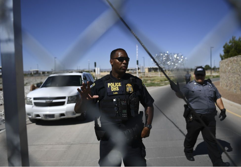 Security tell people to stop as they approach the border crossing fence at the Tornillo Port of Entry near El Paso, Texas