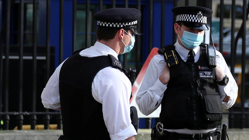 Police officers wearing face masks