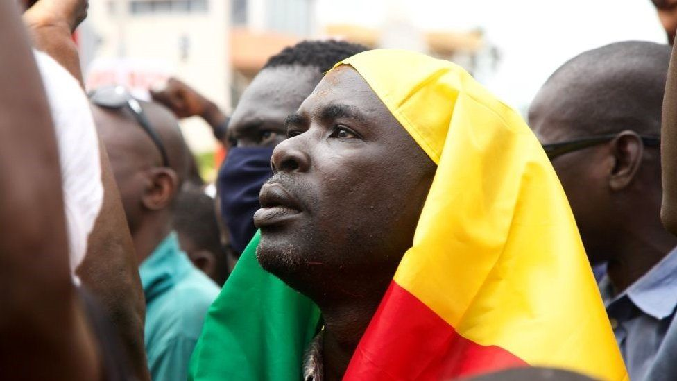 A man looks on during a protest to support the Malian army in Bamako, Mali, on August 21, 2020