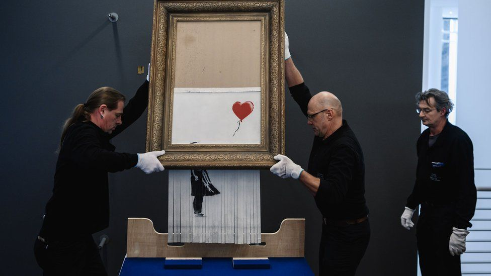 Banksy's Girl with Balloon after the canvas passed through a hidden shredder.