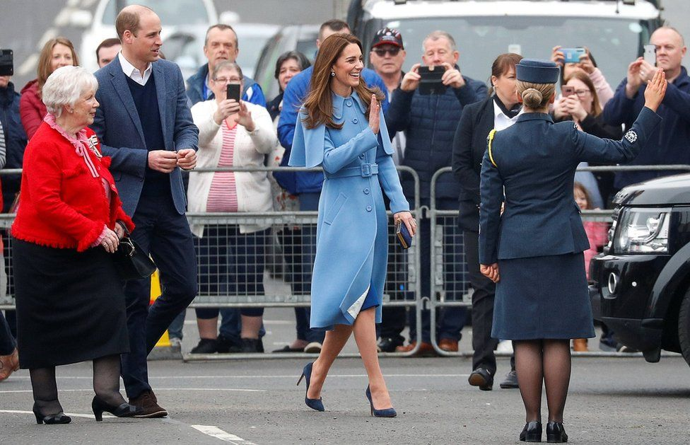 William and Kate wave to the crowd in Ballymena