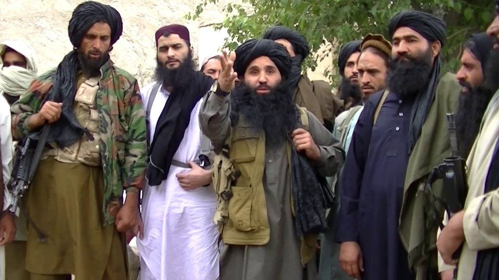 A grab taken from an undated handout video released by the Tehrik-e-Taliban Pakistan (TTP) shows its head Mullah Fazlullah (centre) at an undisclosed location at Pak-Afghan border (file photo)