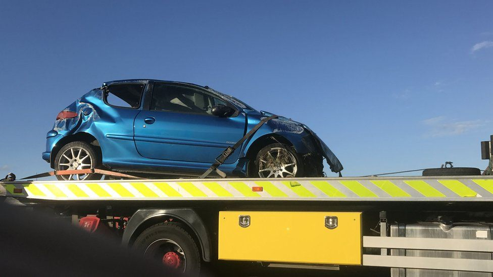 Car being removed from the scene