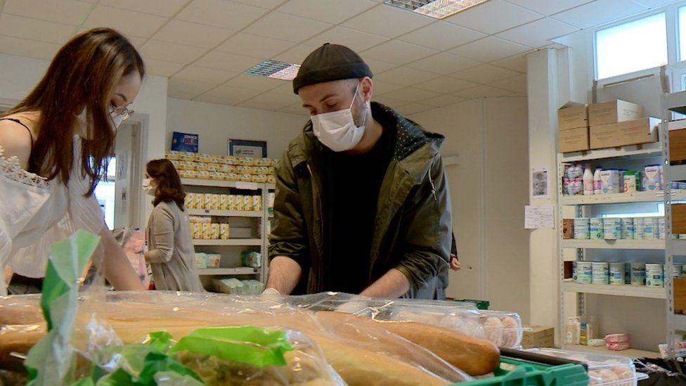 Volunteers inside a food bank at Montmartre