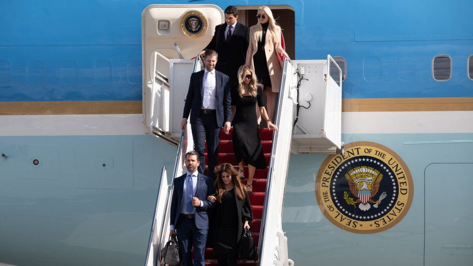 The Trump children and their partners deplane Air Force One in Florida
