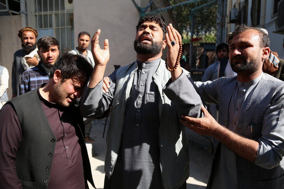 Brother of a female doctor Sadaf, who was killed in a roadside bomb blast, reacts as he waits to receive her body at a hospital, in Jalalabad, Afghanistan, 04 March 2021.