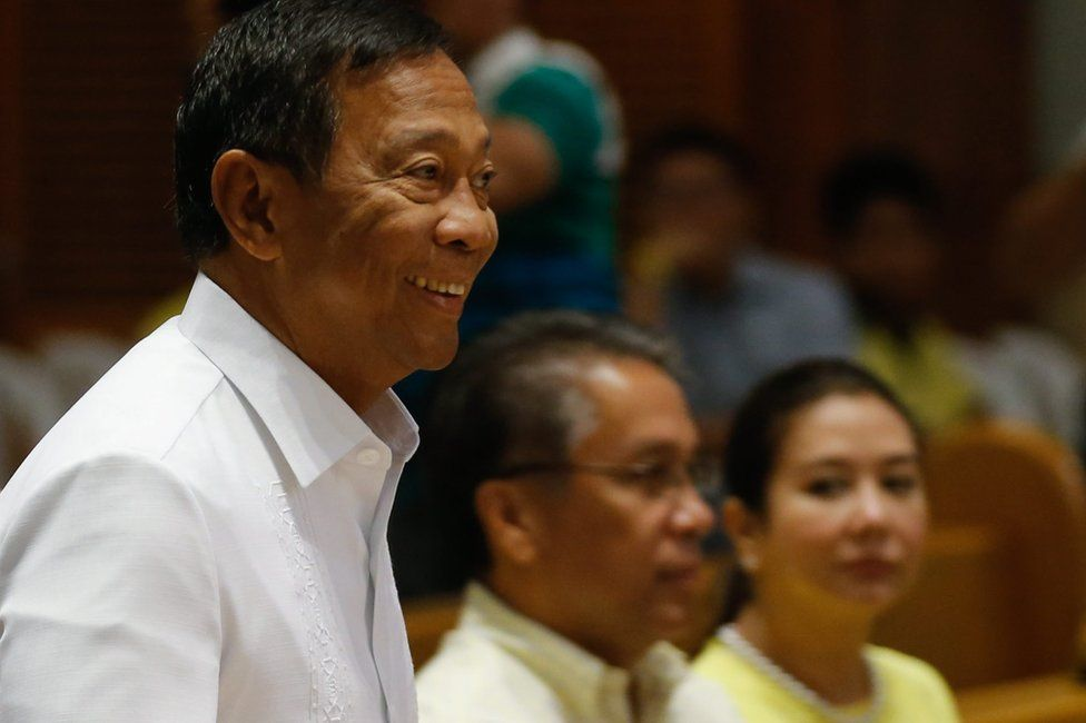"""Filipino Presidential candidate Jejomar Binay (left) arrives in Manila Cathedral as Filipino Liberal Party presidential candidate, Manuel """"Mar"""" Roxas III and his wife, broadcaster Korina Sanchez-Roxas, look on, on 2 May 2016"""