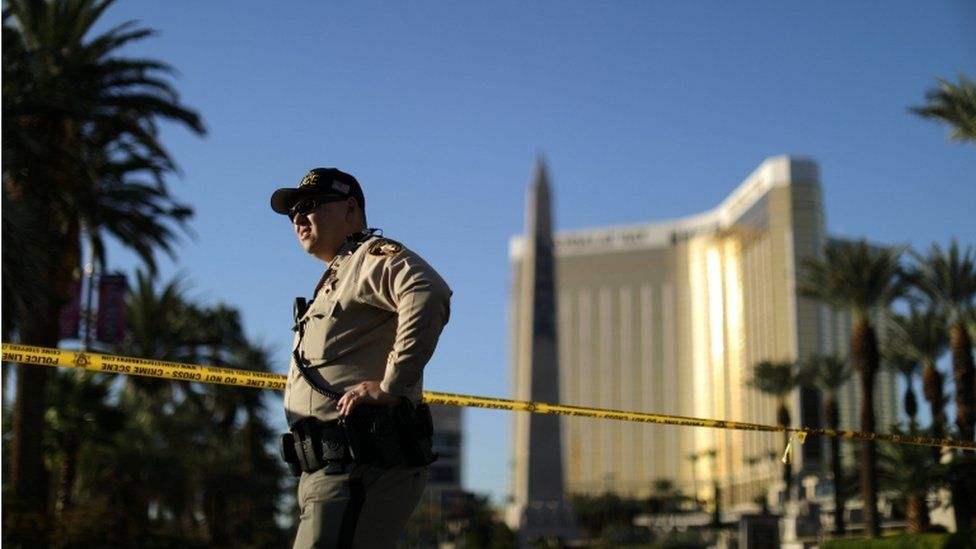 An officer stands outside of Mandalay Bay hotel