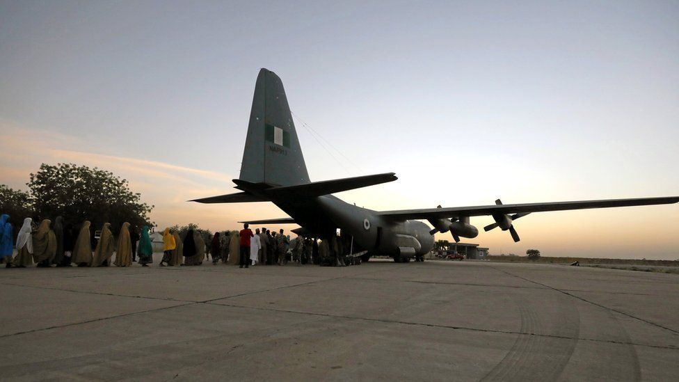 Dozens of kidnapped girls from Dapchi, northern Nigeria lined up waiting to board a plane at an air force base Maiduguri, Nigeria.