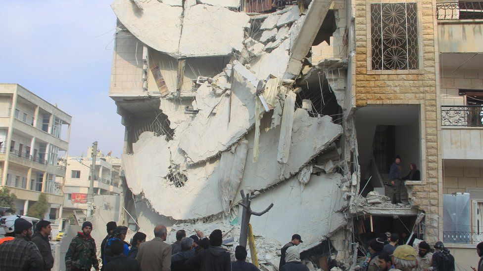People inspect a site hit by what activists said were Russian air strikes in Idlib. Photo: December 2015