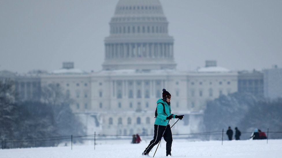 A cross country skier passes the US Capitol during a winter storm January 13, 2019 in Washington