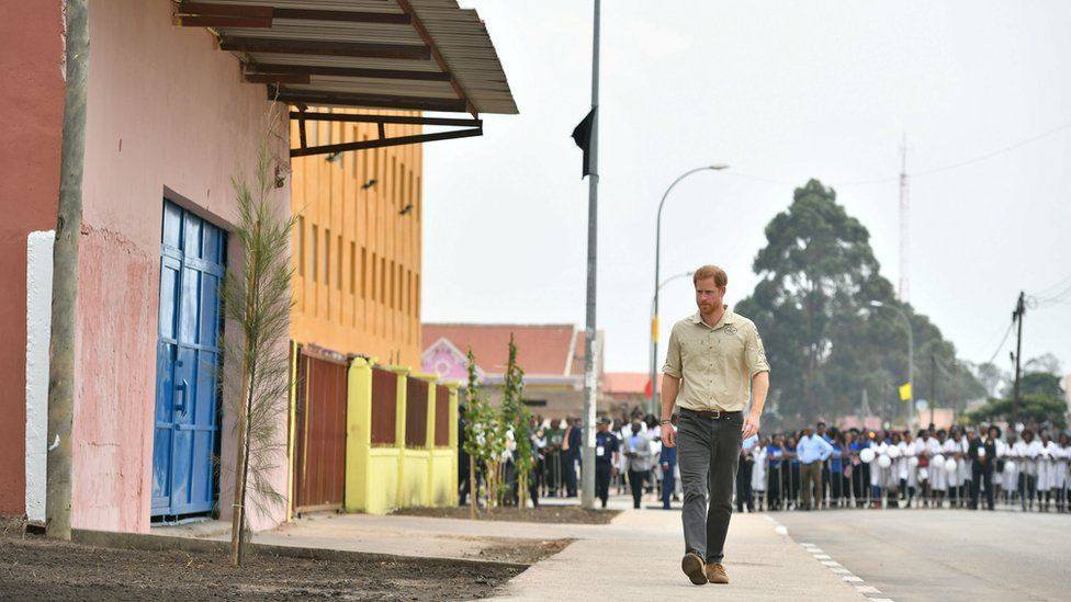 Prince Harry, Duke of Sussex, walks on Princess Diana Street on day five of the royal tour of Africa, in Huambo